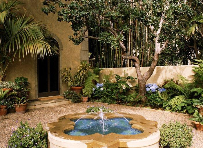 Italian Mediterranean Garden With Small Fountain In The