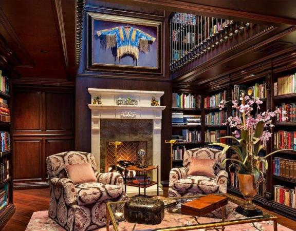 Luxurious and Elegant Traditional Mansion Interior Design   Founterior Luxurious traditional home library   with wood shelves and club armchairs