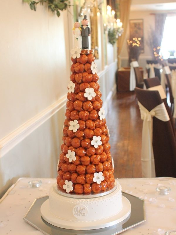croquembouche  french wedding cake   French Wedding Cakes Traditional French Wedding cakes made of profiteroles filled with creme  patissiere and lightly coated with crispy caramel