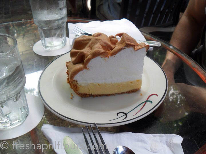 slice of authentic key lime pie on a plate in a restaurant