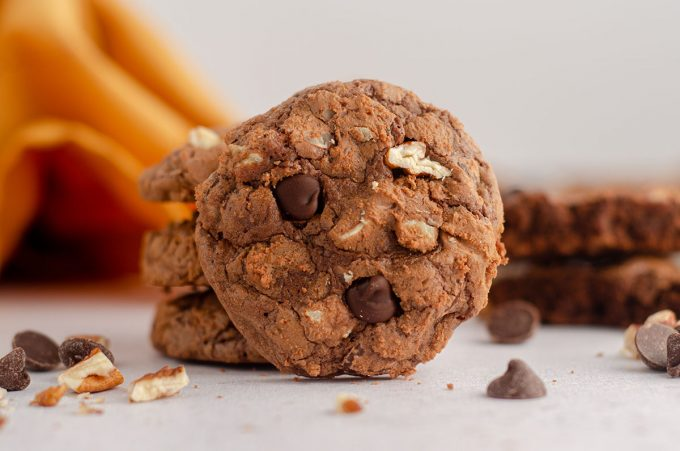 a brownie cookie leaning on a stack of other brownie cookies