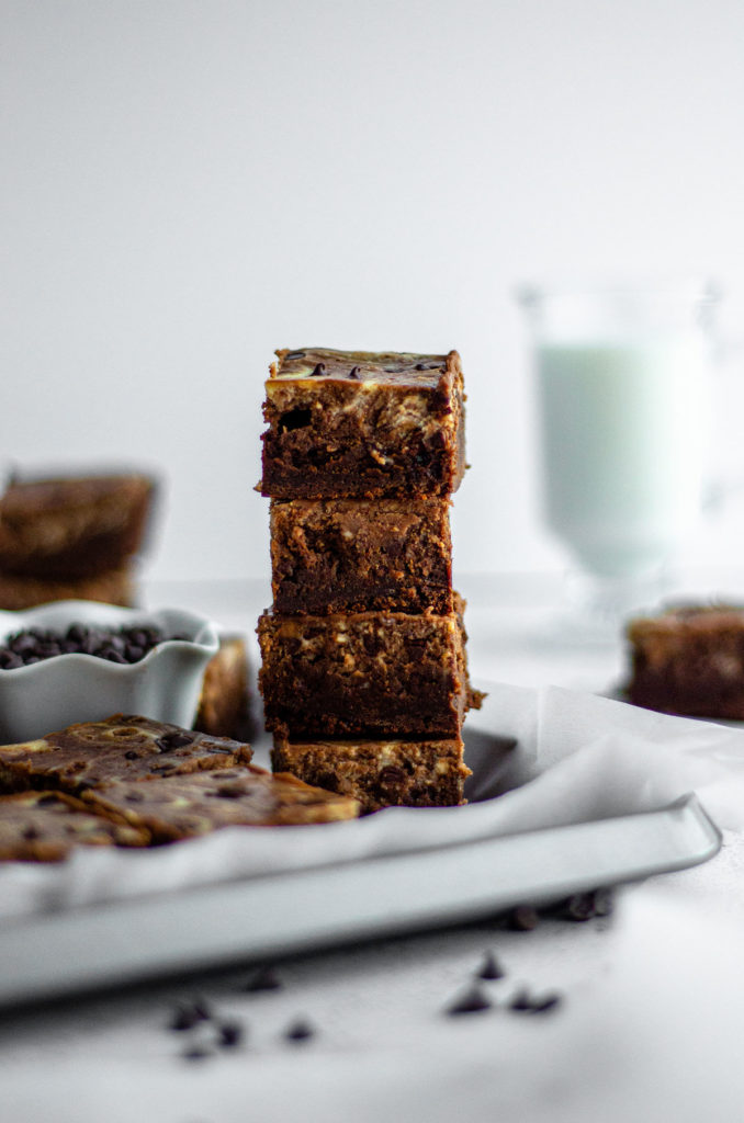 stack of brownies with glass of milk