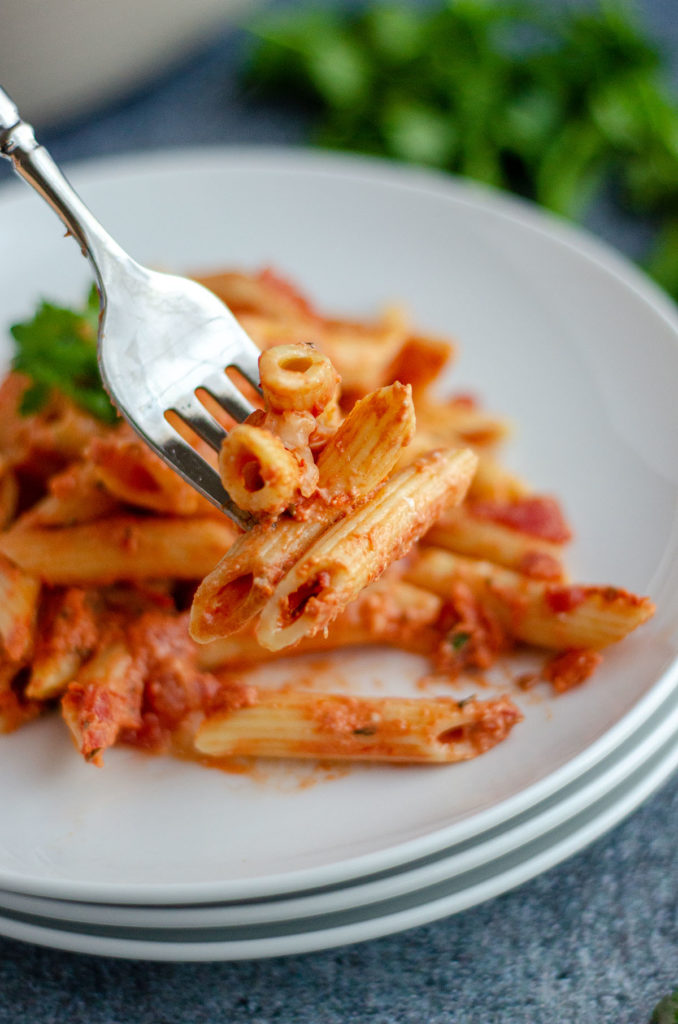 fork speared into baked ziti