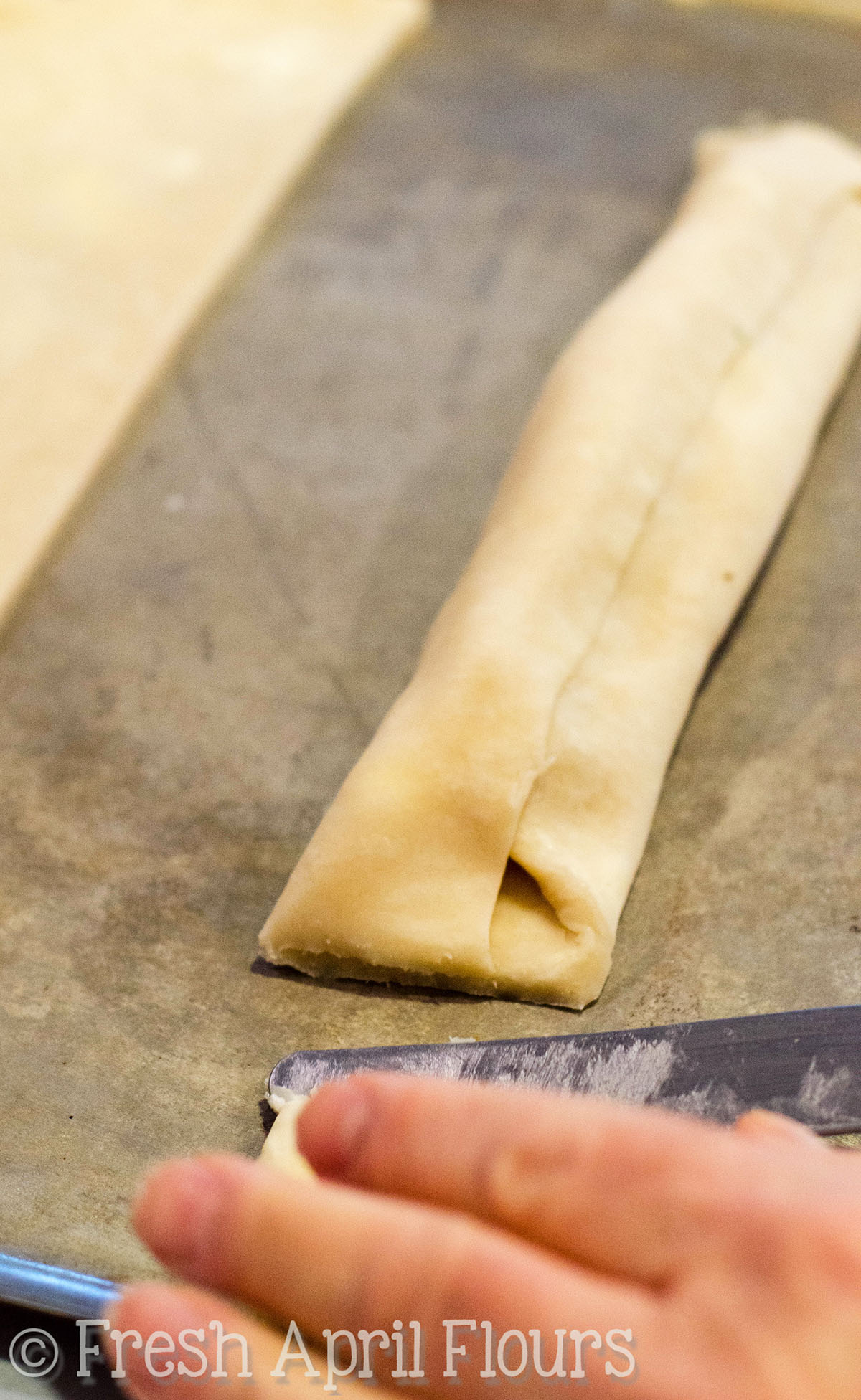 cutting off the ends of honey walnut cookie sticks