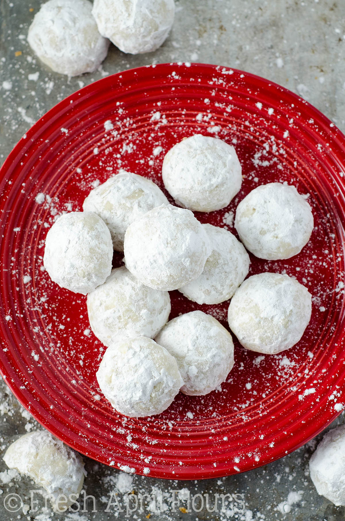 russian tea cakes on a red plate