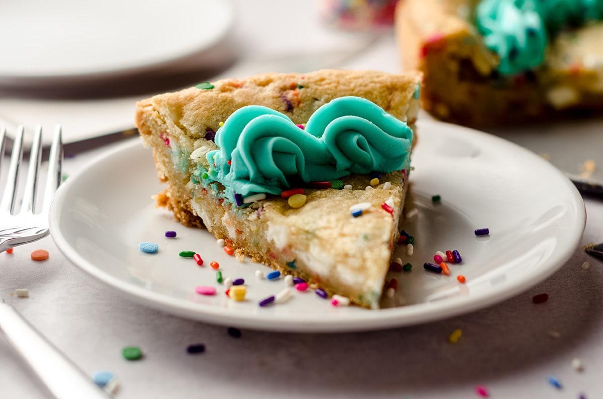 a slice of funfetti sugar cookie cake on a plate