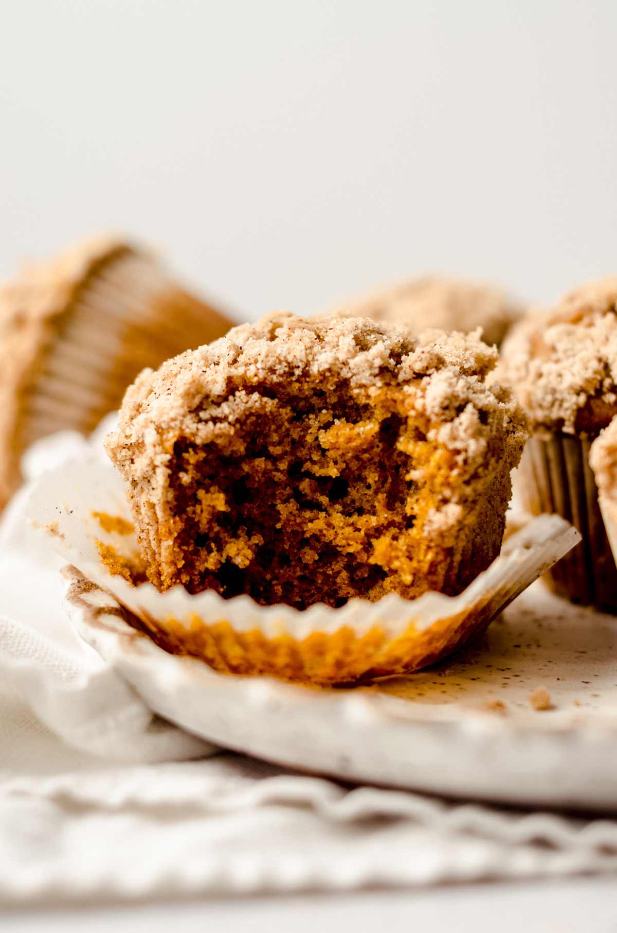 pumpkin streusel muffin with a bite taken out of it