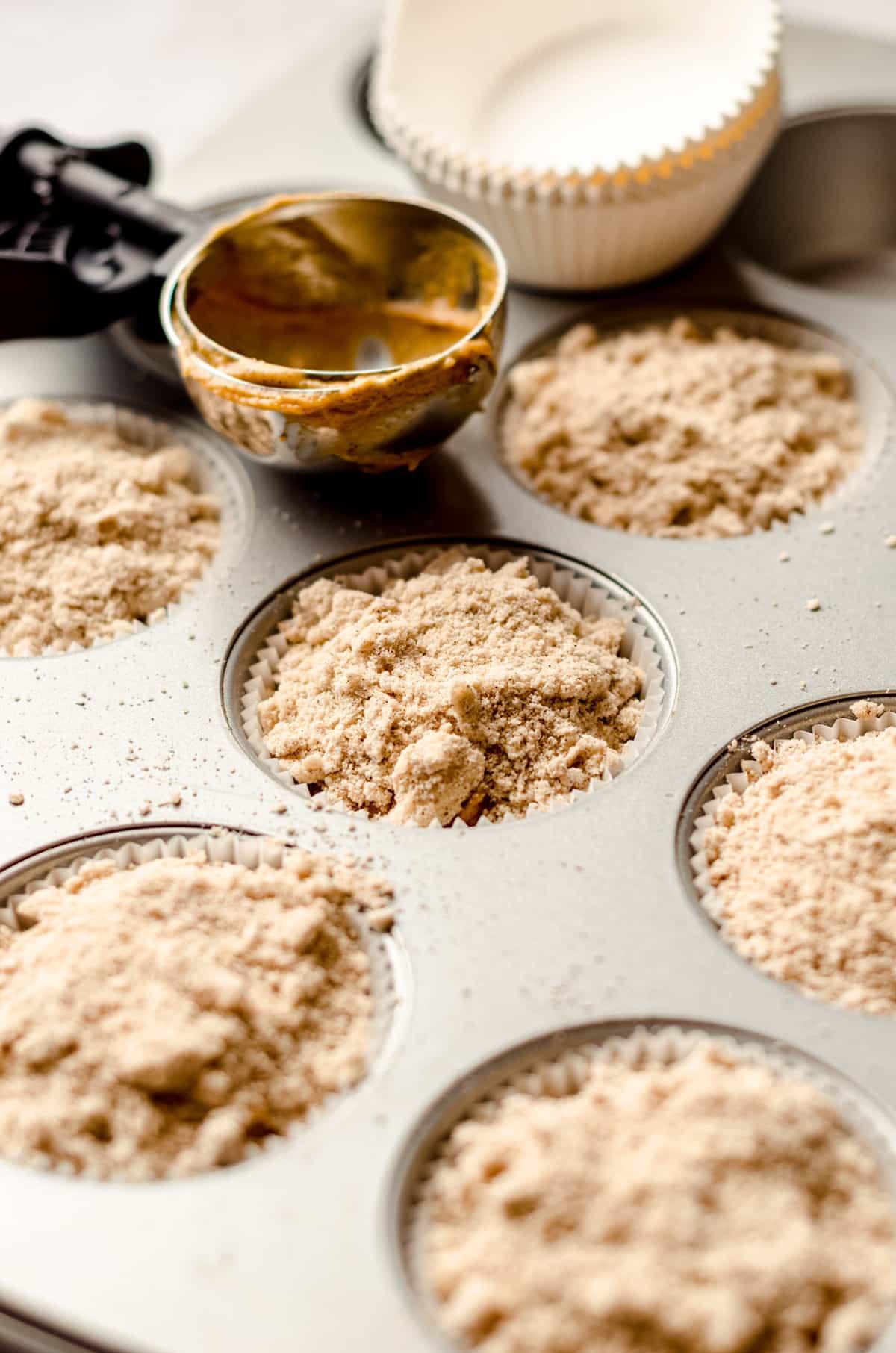 pumpkin streusel muffin batter in a muffin pan ready to bake