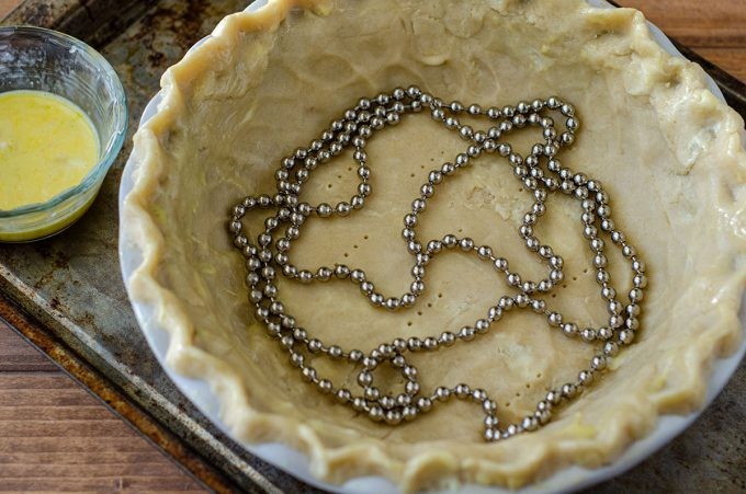 pie chain in a pie crust before blind baking