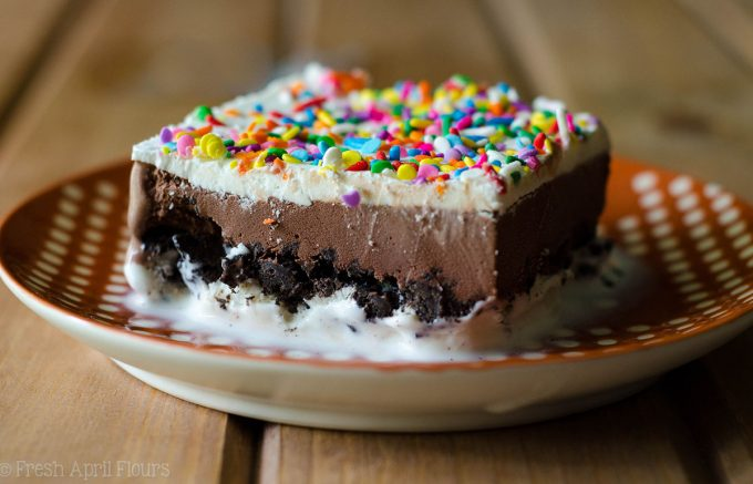 Ice Cream Sheet Cake: An easy recipe for homemade ice cream cake, filled with a crunchy cookie layer. Mix and match your favorite ice cream flavors or be brave and use your own homemade ice cream!