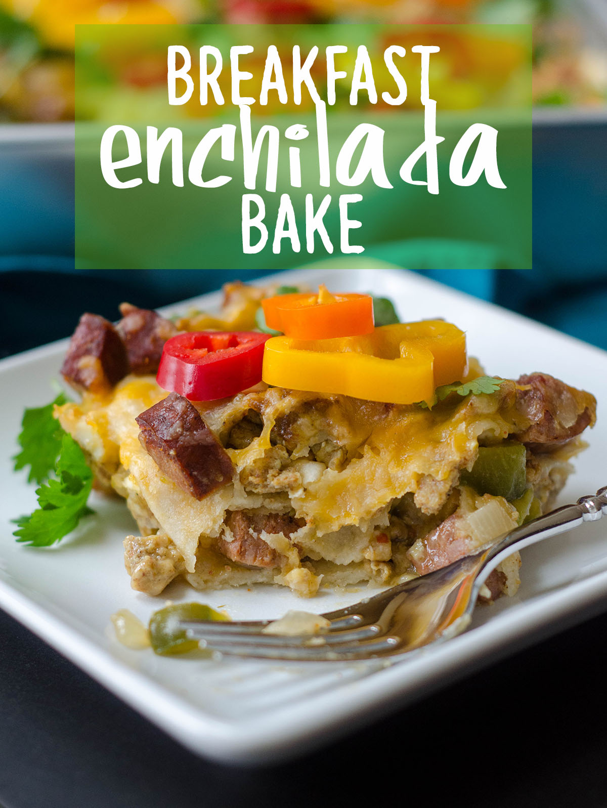 Enchilada Breakfast Bake: Seasoned scrambled eggs and vegetables combined with spicy chorizo, and layered between corn tortillas and enchilada sauce for an easy and flavorful breakfast dish.