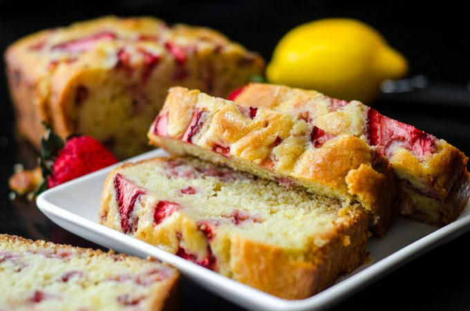slices of strawberry lemonade quick bread on a white plate
