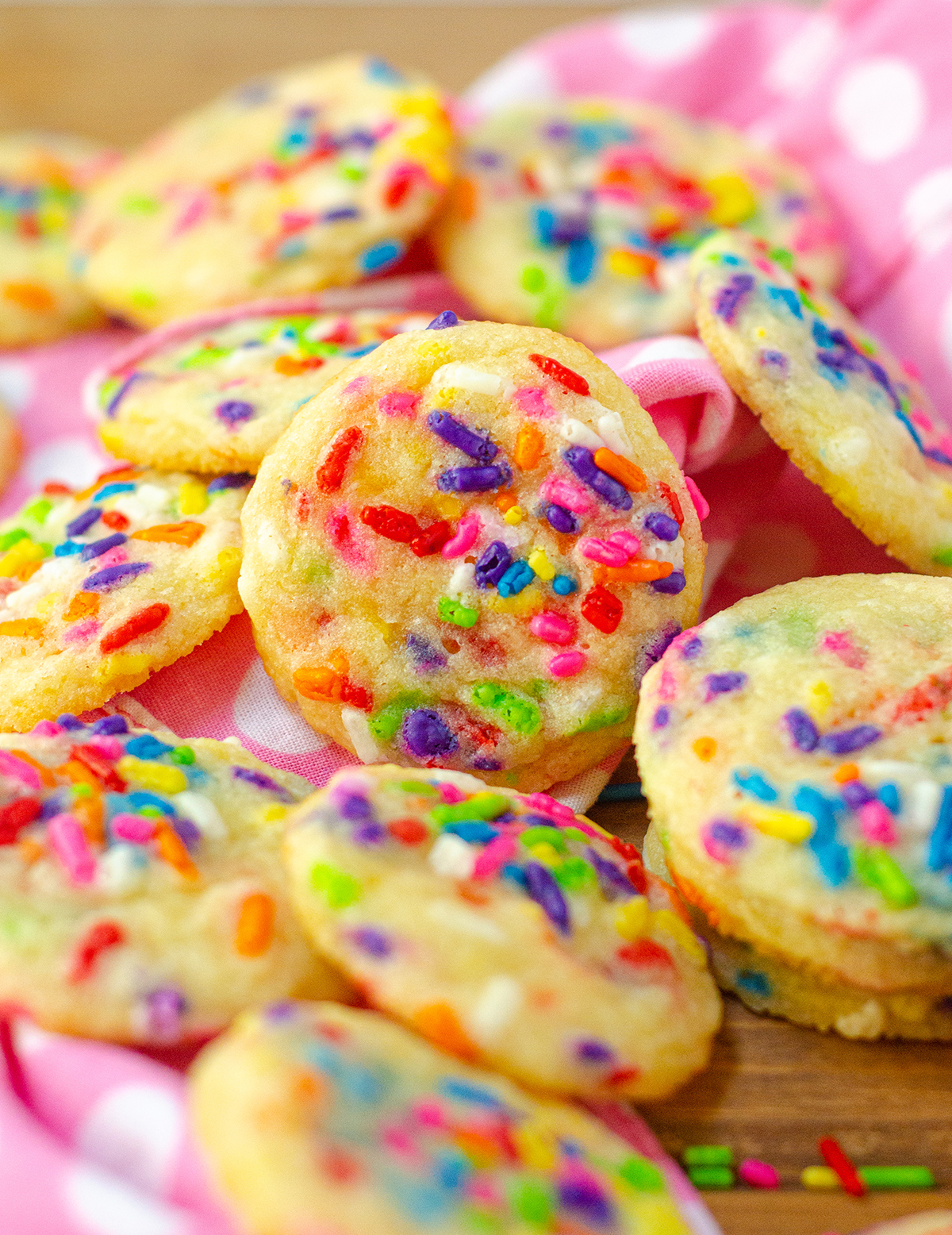 Soft and chewy sugar cookies filled with sprinkles. Keep them mini or make them standard size. Fill with your favorite holiday sprinkles!