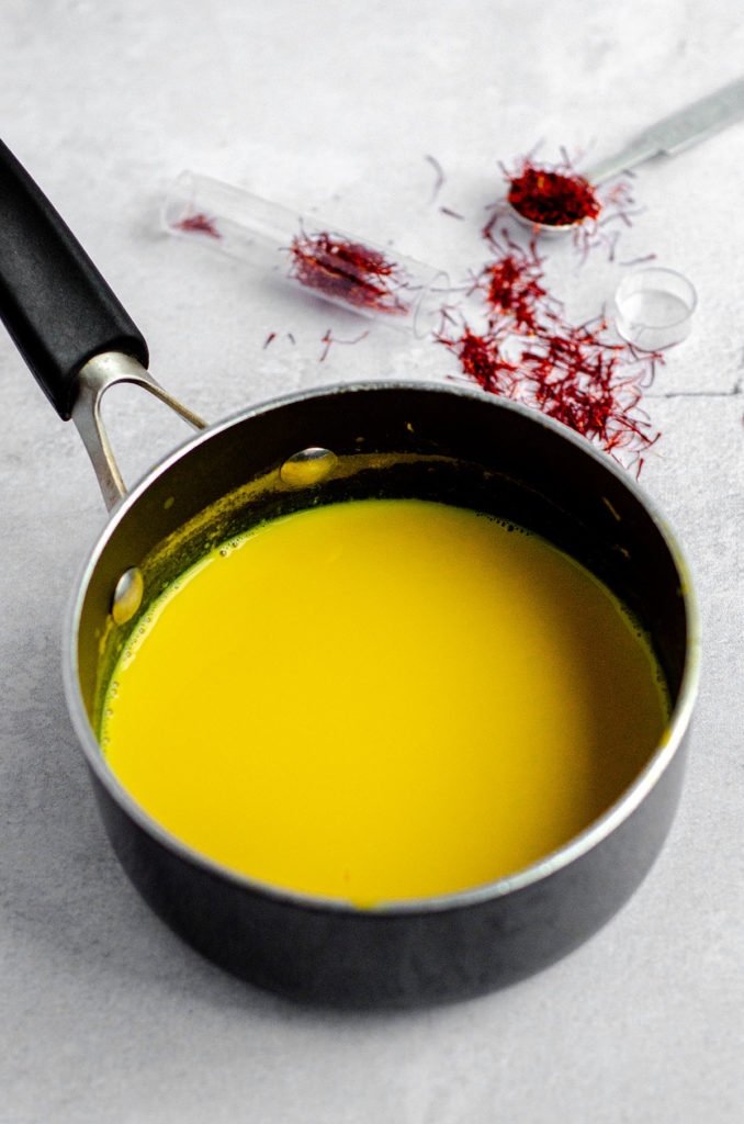 saffron-infused milk in a saucepan