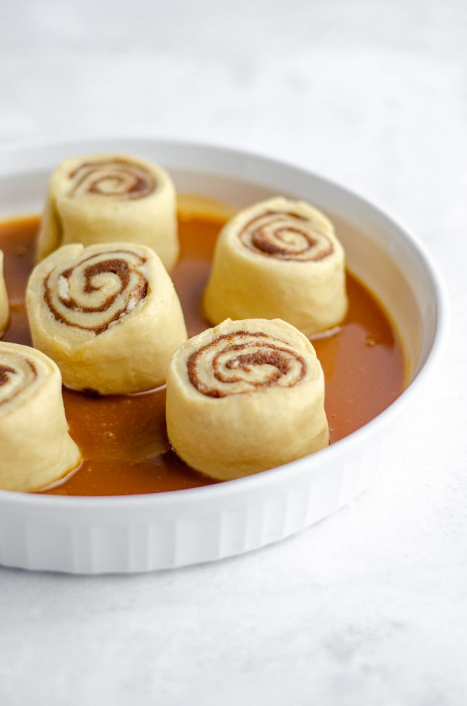 Caramel Rolls with Caramel Cream Cheese Frosting: Easy small batch caramel cinnamon rolls drenched in salted caramel sauce and topped with a creamy salted caramel cream cheese frosting.