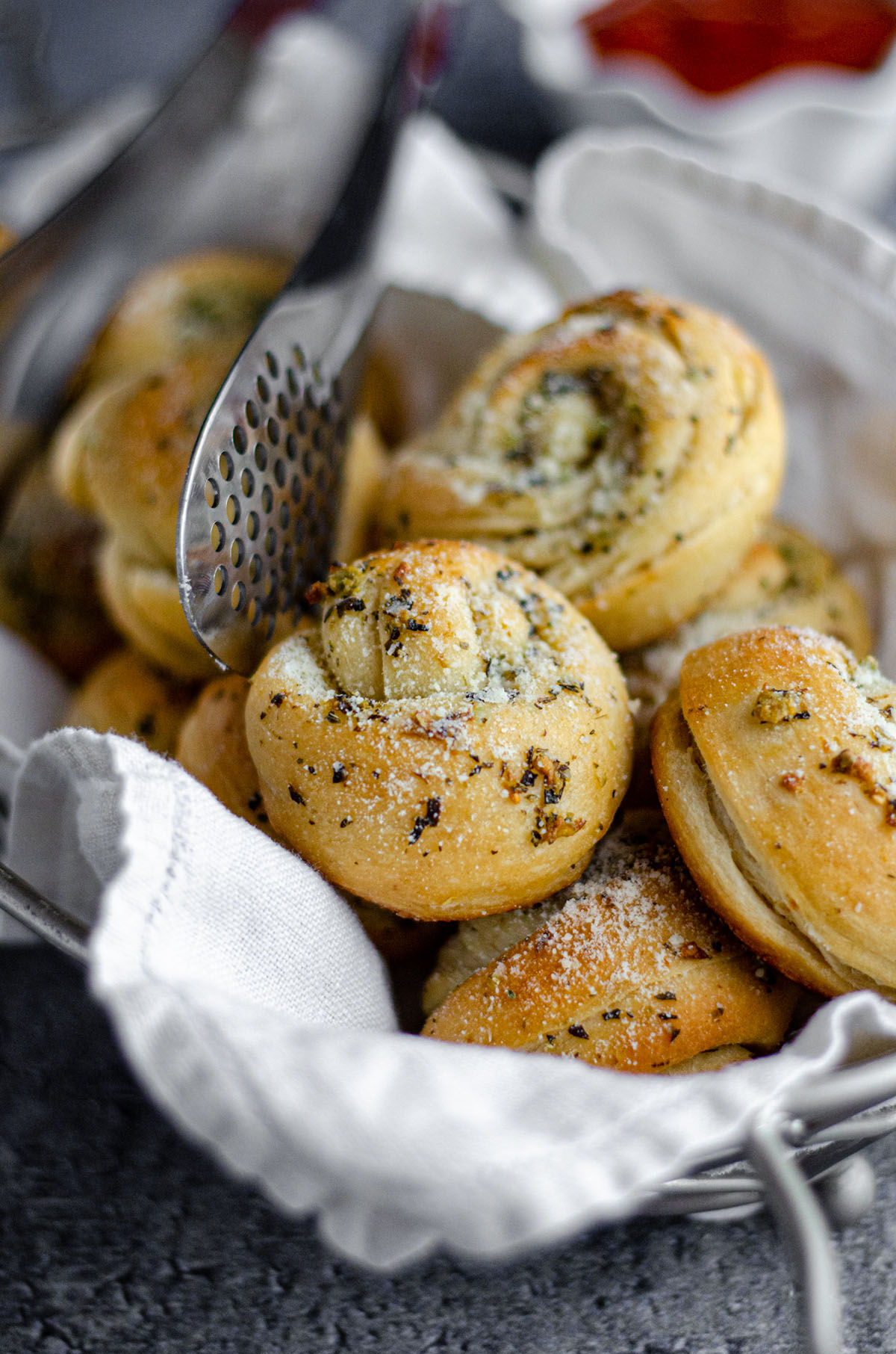 Homemade Garlic Knots: Easy garlic knots made from store bought pizza dough. Crunchy and flavorful on the outside, soft and fluffy on the inside, and ready in less than 30 minutes.