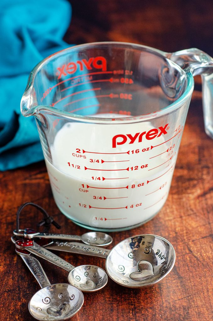 homemade buttermilk in a glass measuring cup