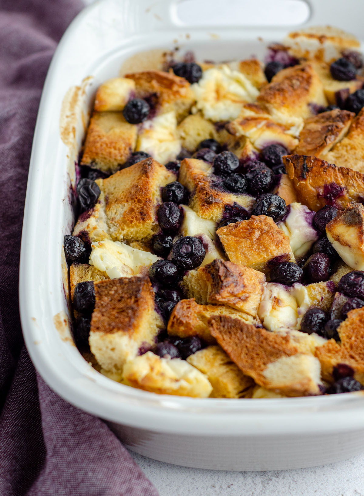baked blueberry french toast in a casserole dish