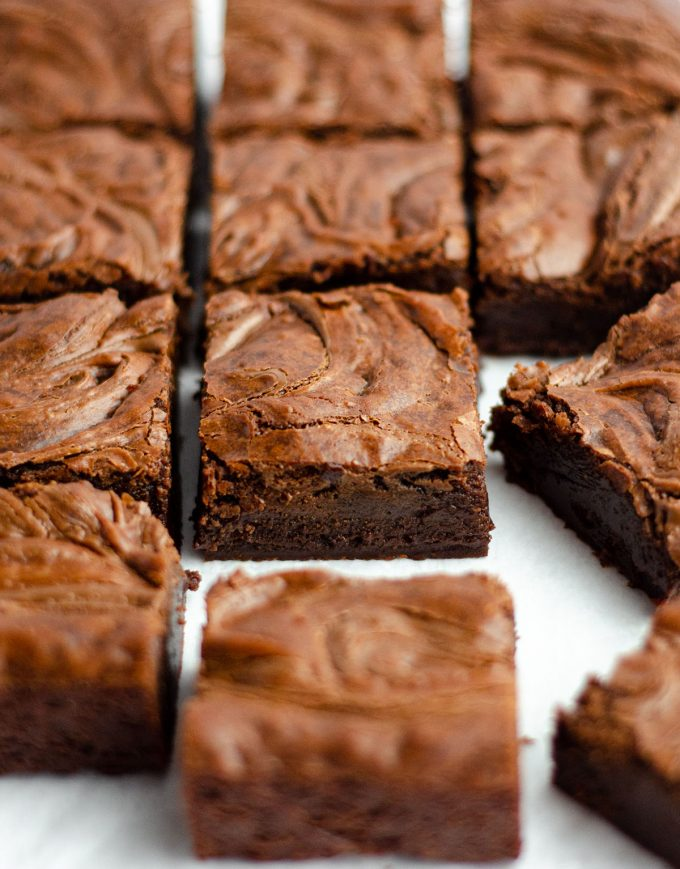 fudgy nutella brownies sliced and sitting on a white surface