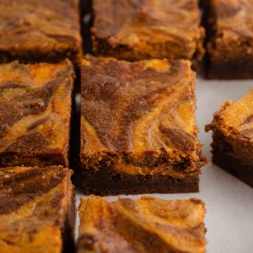 sliced pumpkin cheesecake brownies