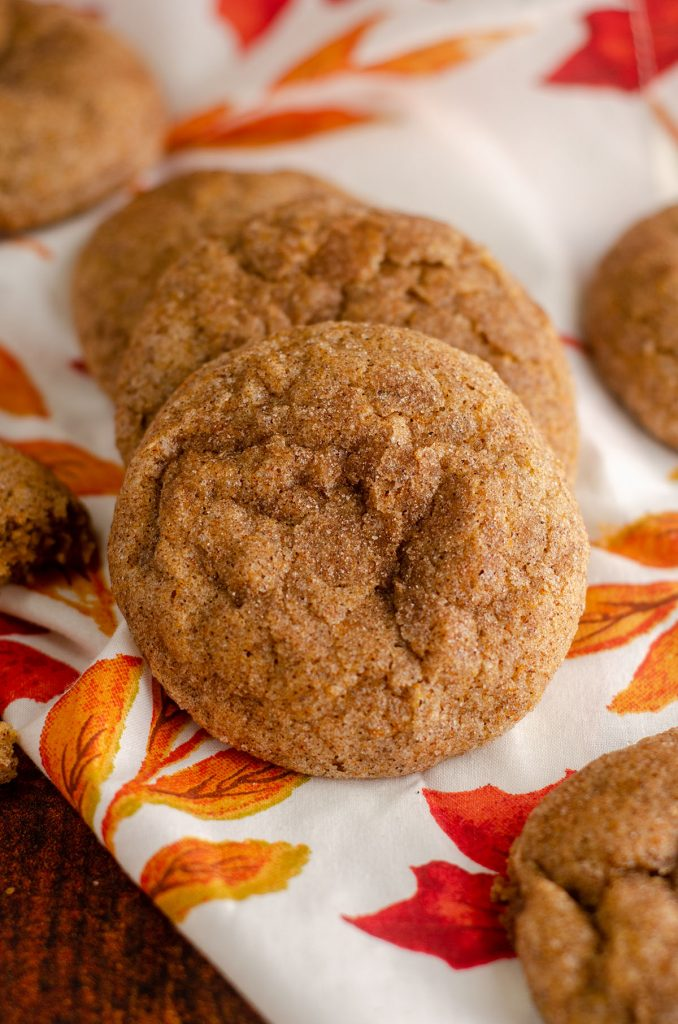 pumpkin spice cookies sitting on a fall leaves kitchen napkin