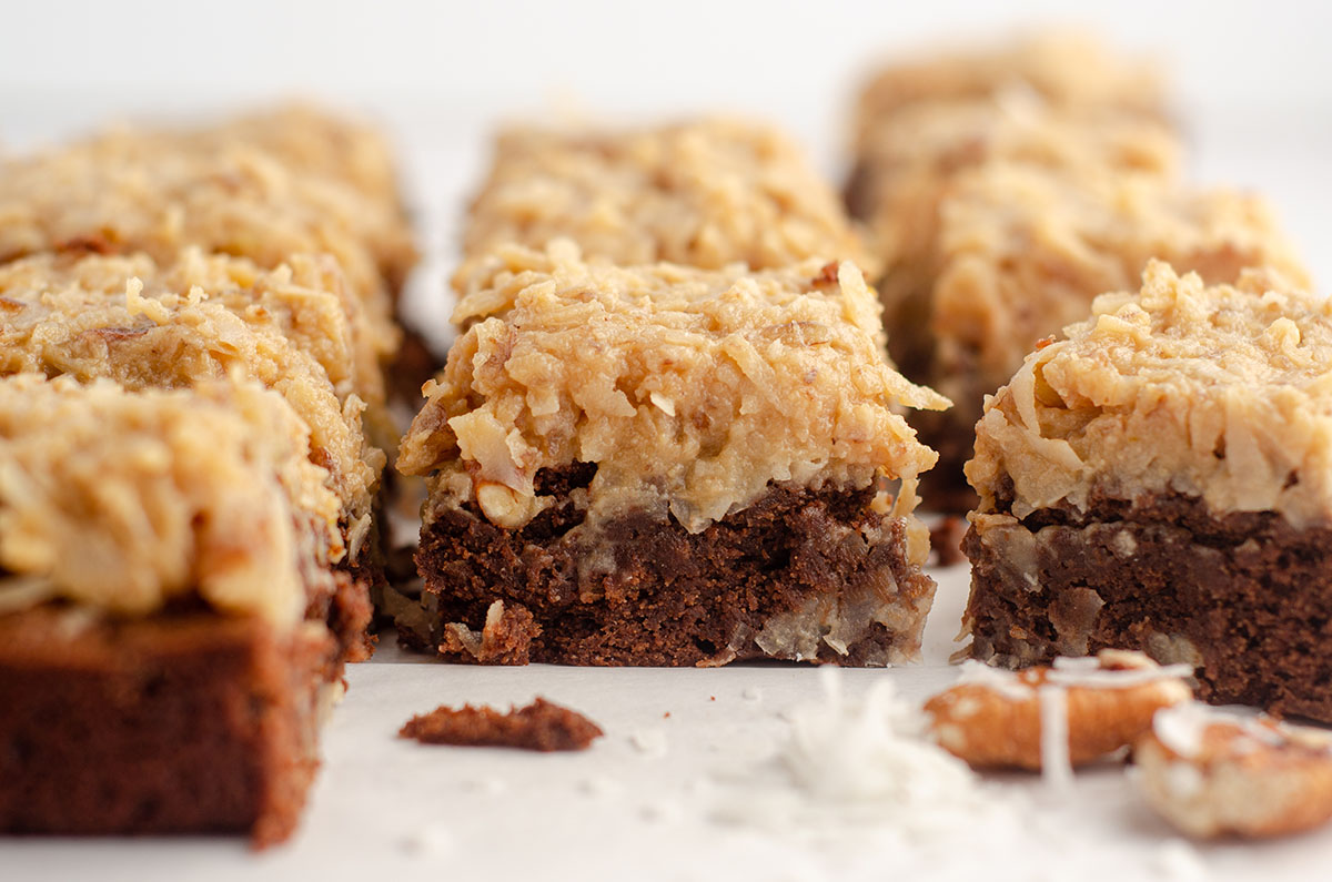 german chocolate brownies with pecans and coconut scattered around