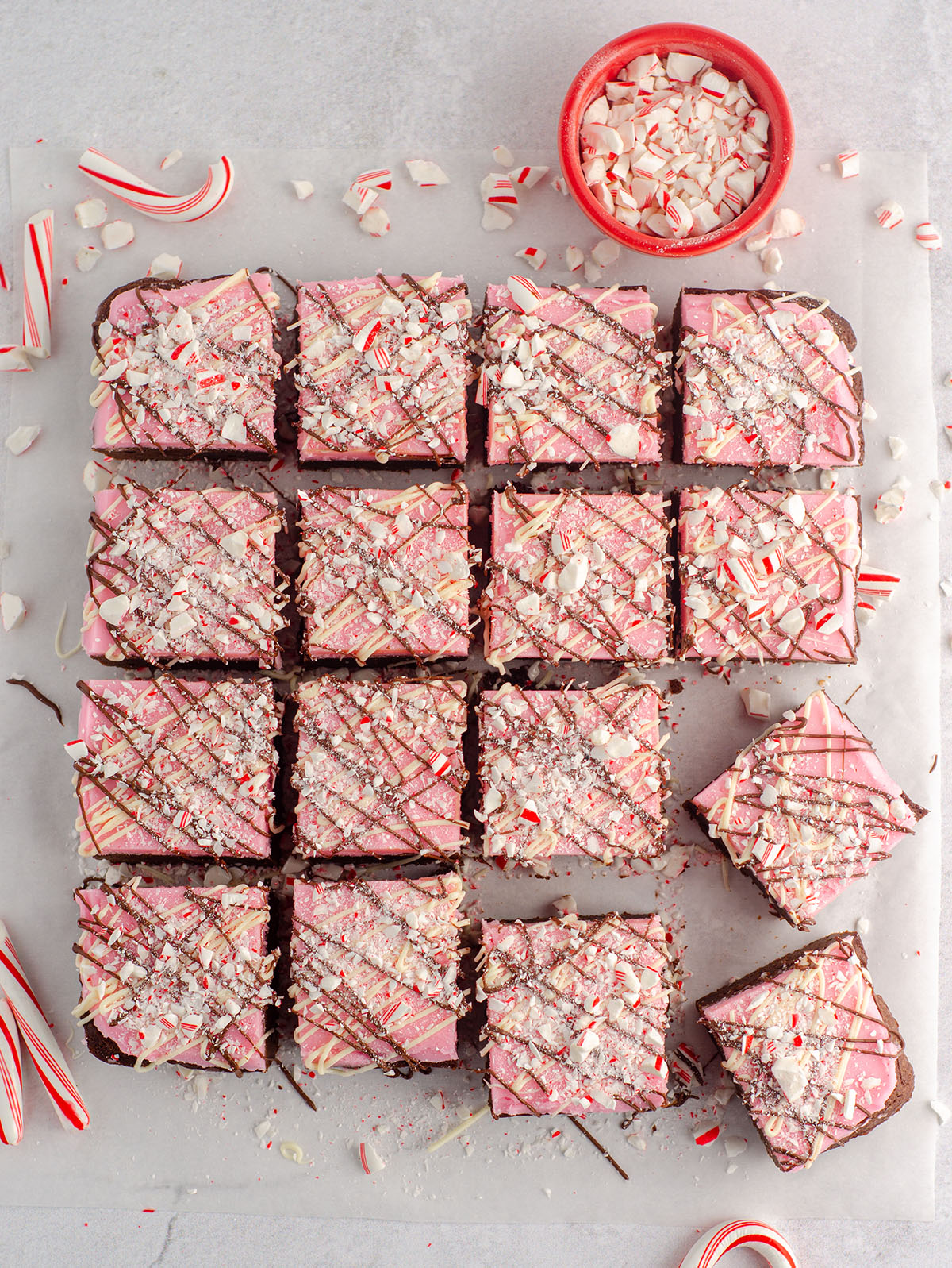 aerial photo of peppermint brownies with candy canes crushed on top