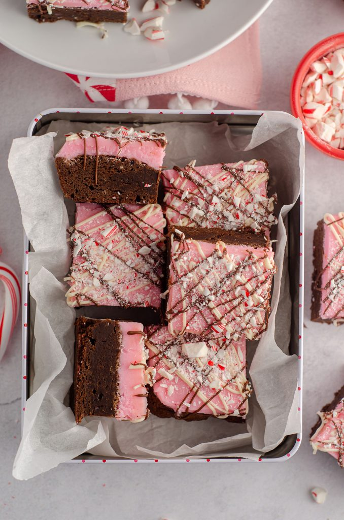 aerial photo of peppermint brownies sitting in a treat box ready to gift