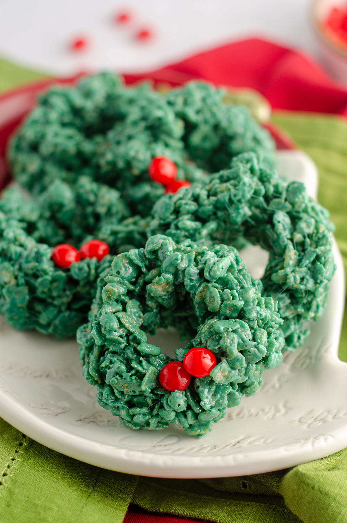 rice krispies wreaths sitting on a plate