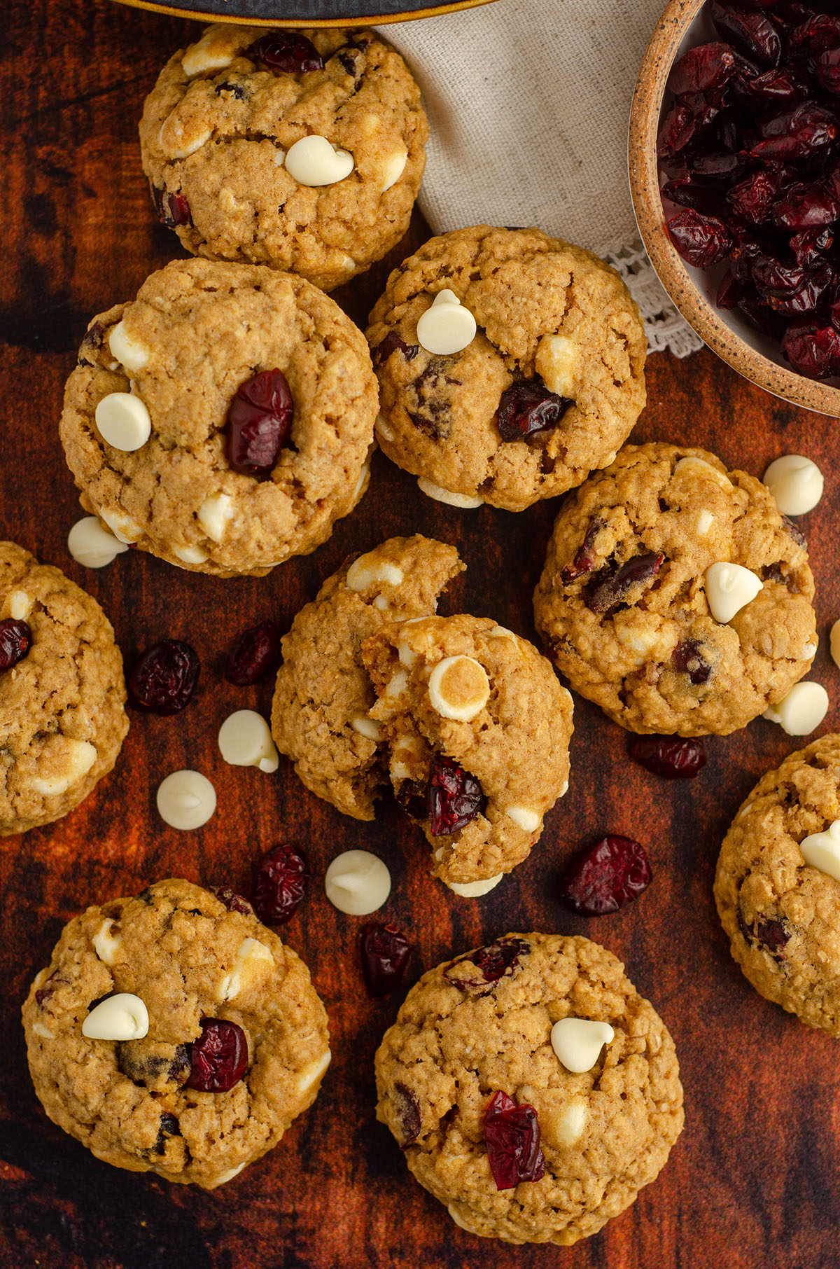 aerial photo of white chocolate cranberry oatmeal cookie broken apart to see the inside