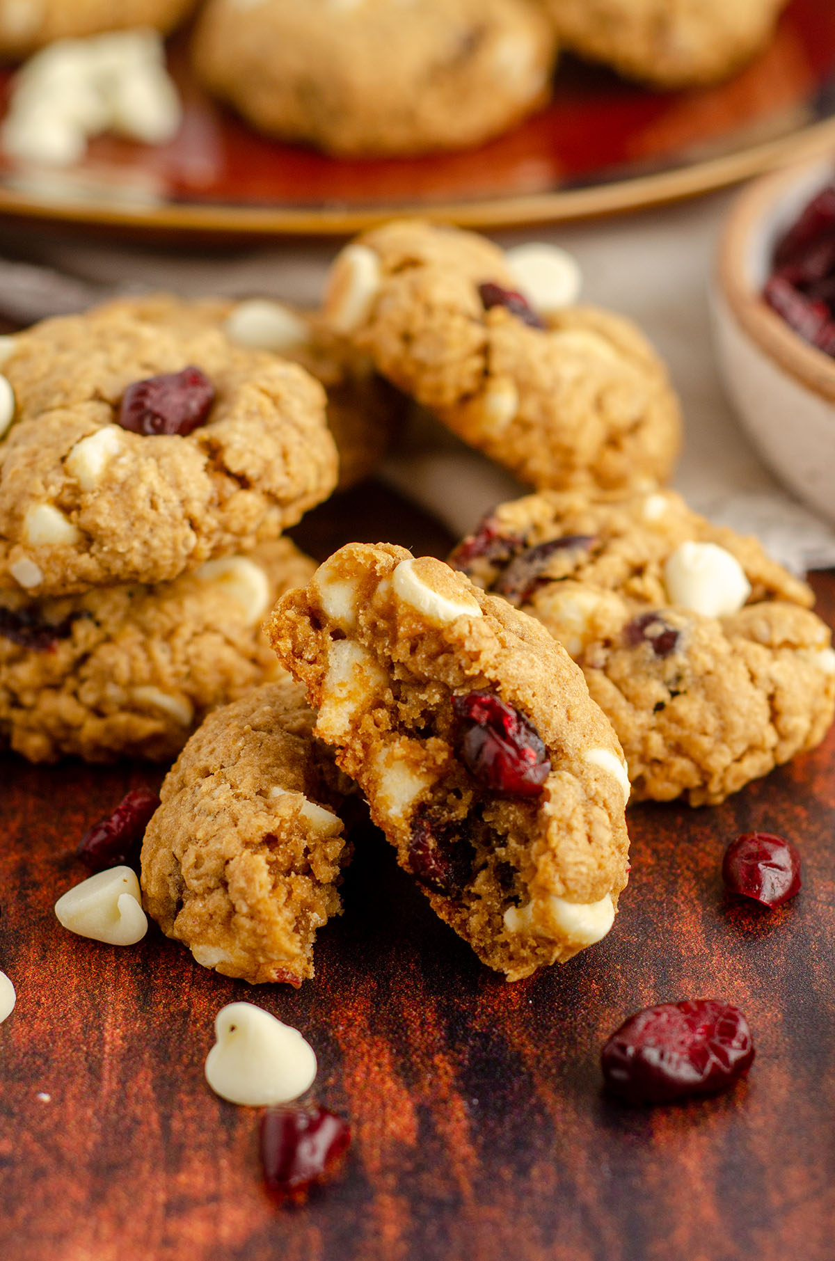 white chocolate cranberry oatmeal cookie broken apart to see the inside