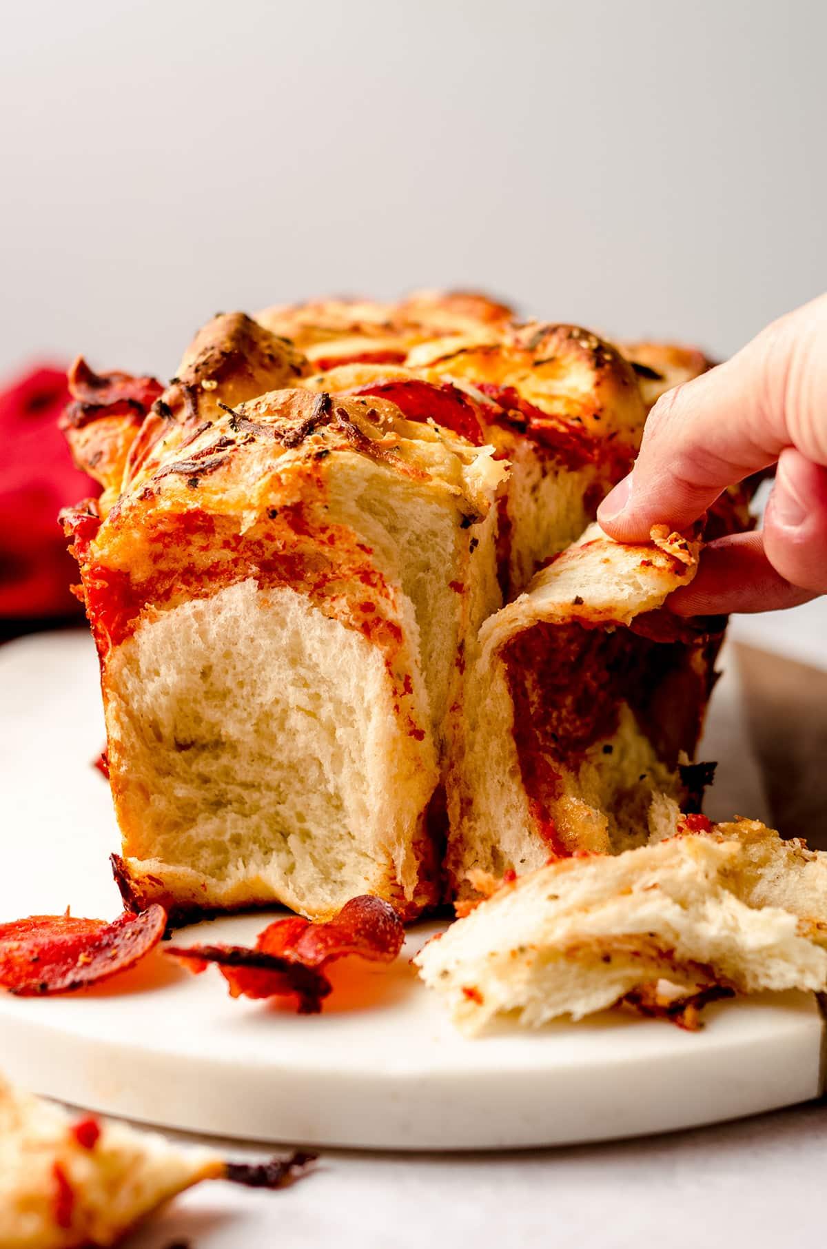 hand pulling apart pizza pull apart bread