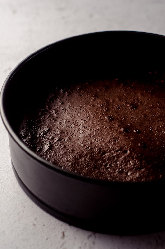 springform pan with gluten free dairy free chocolate cake in it