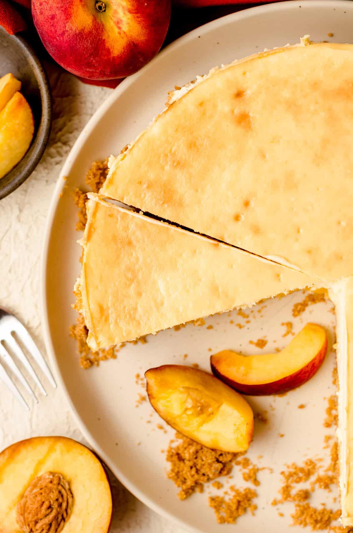 aerial photo of sliced peach cheesecake