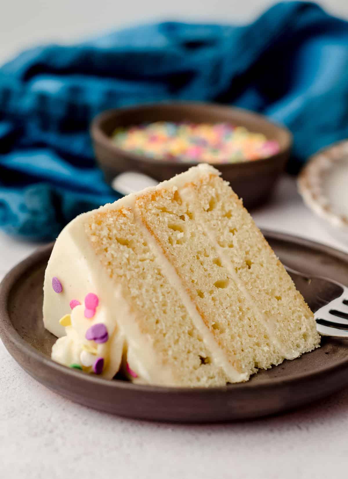 slice of vanilla cake on a plate