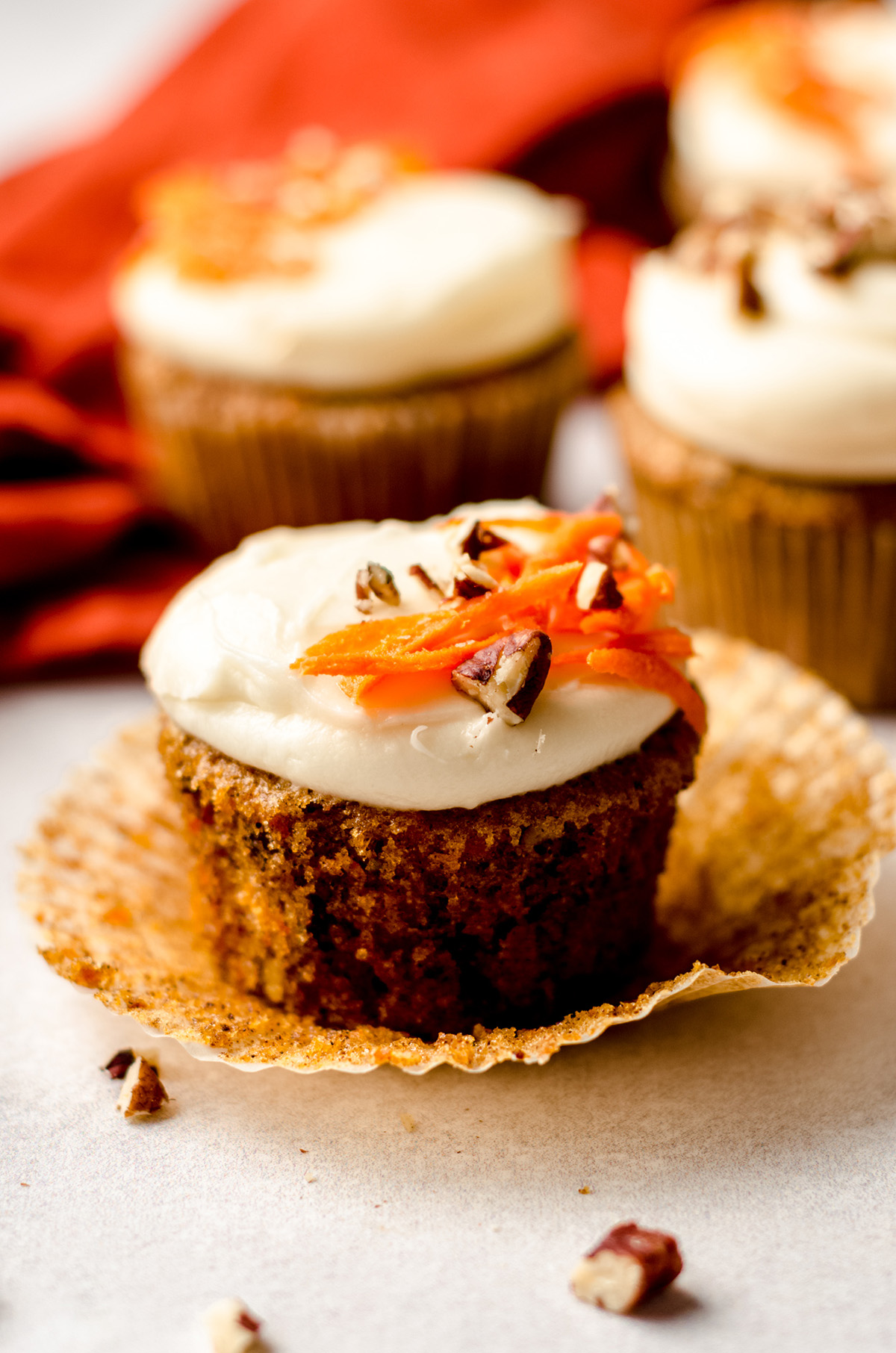 carrot cake cupcakes with cream cheese frosting with the cupcake liner taken off