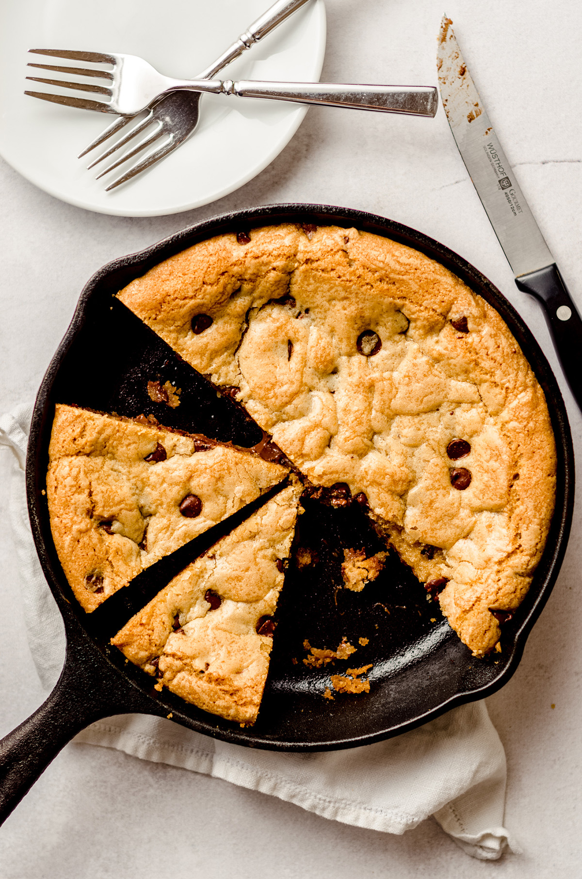 aerial photo of nutella skillet cookie in a cast iron skillet cut into slices