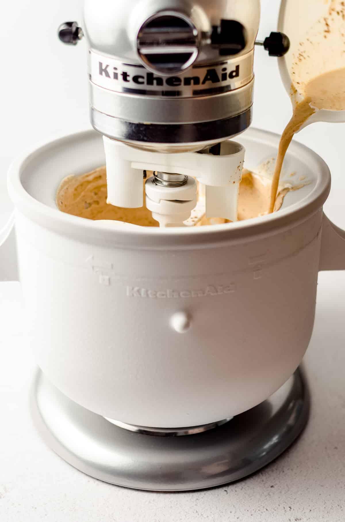 pouring pumpkin ice cream liquid into an ice cream maker