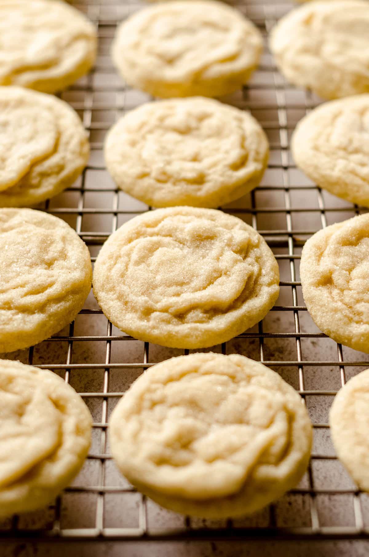 vanilla bean sugar cookies on a cooling rack