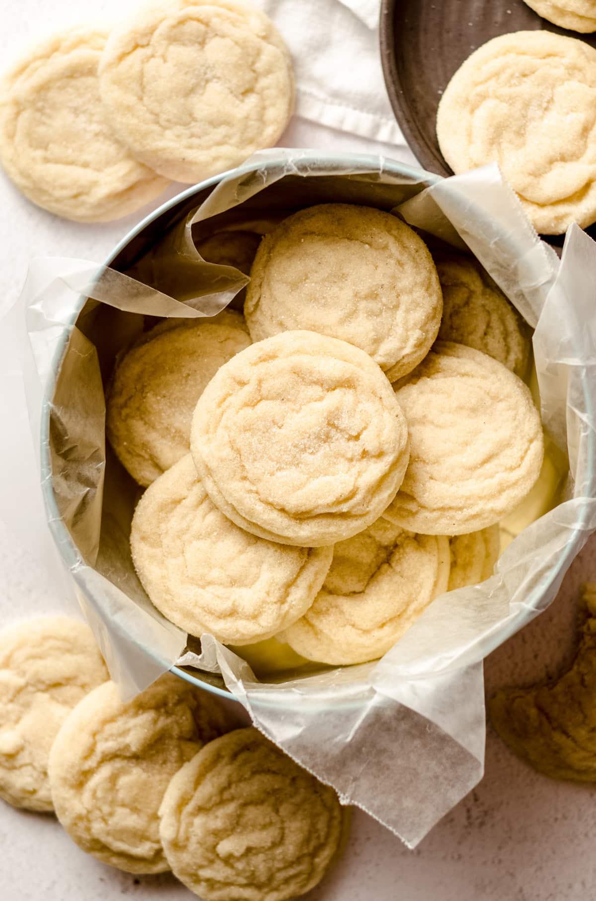 vanilla bean sugar cookies in a cookie tin