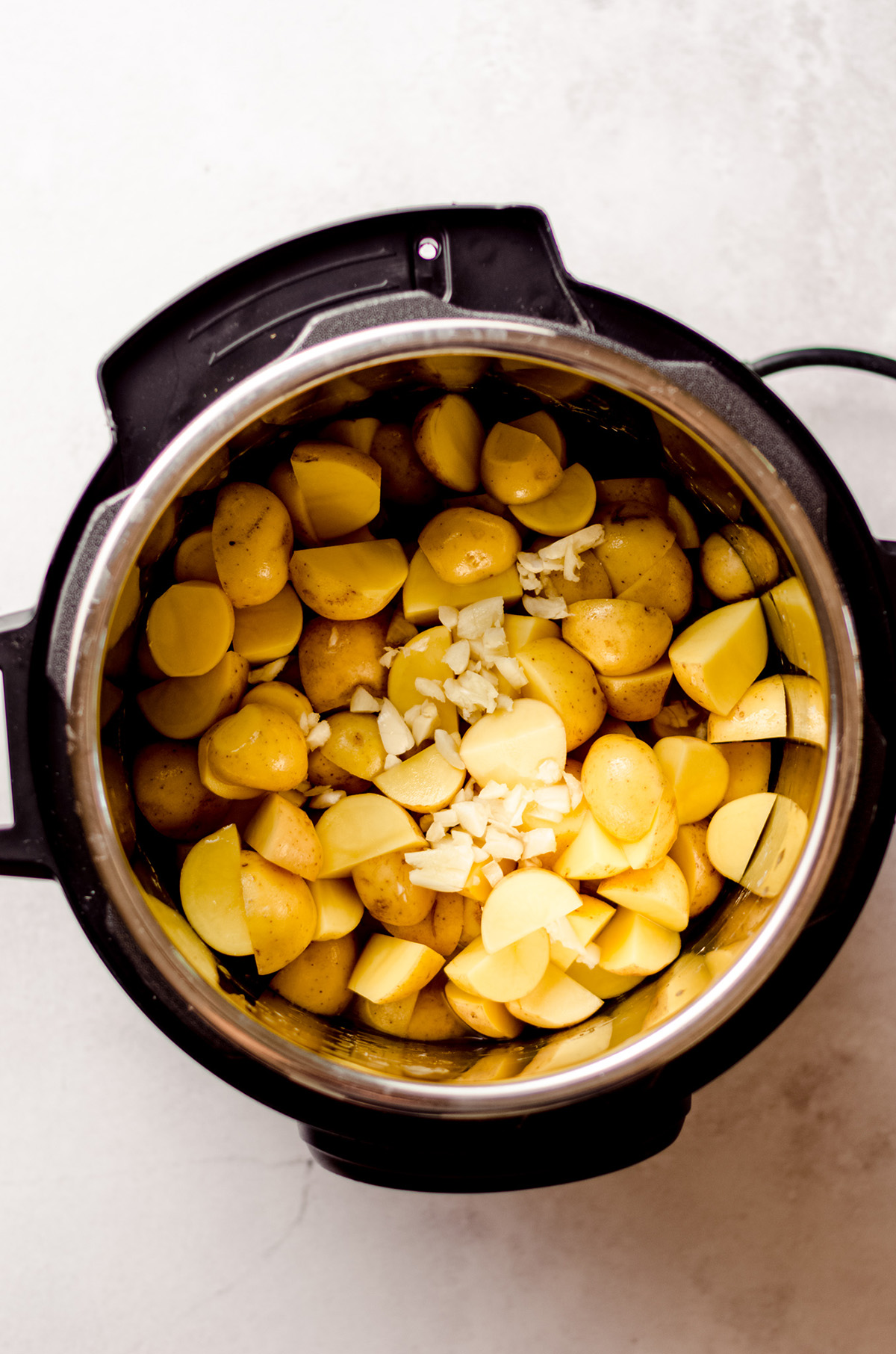 potatoes and garlic in an instant pot ready to make garlic mashed potatoes