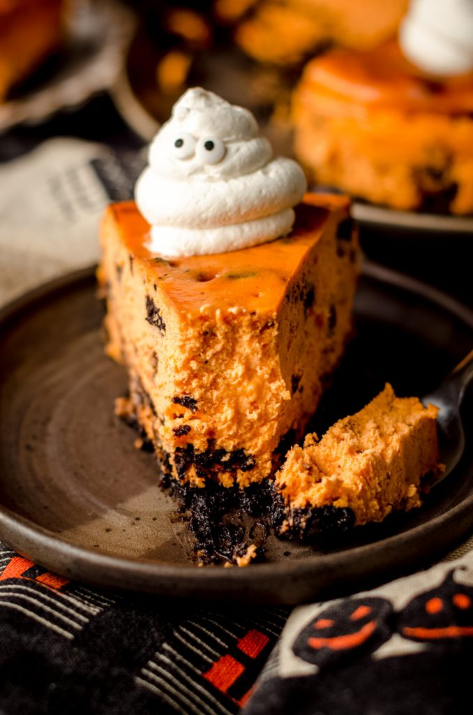 halloween cheesecake with a bite taken out of it