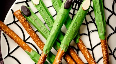 aerial photo of witch finger pretzels on a spider web plate