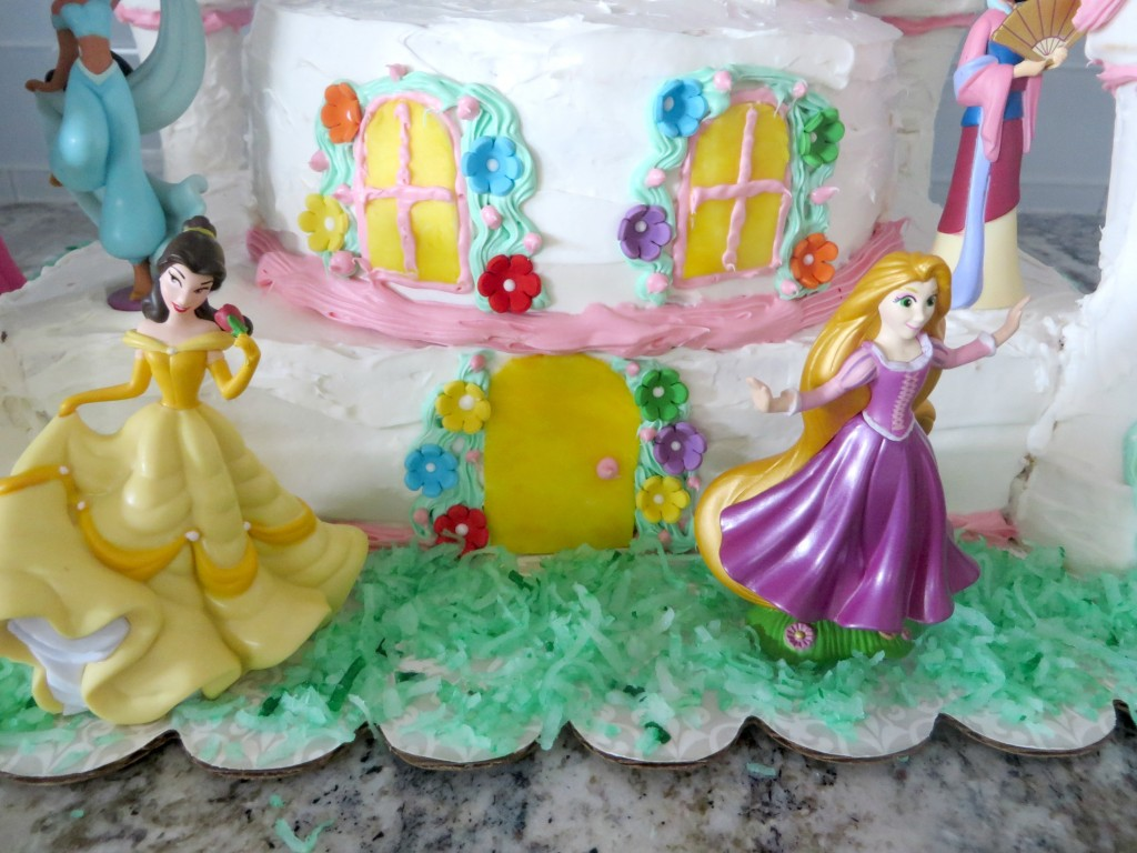 Once you finish this easy castle cake, it's time to add some Disney princesses