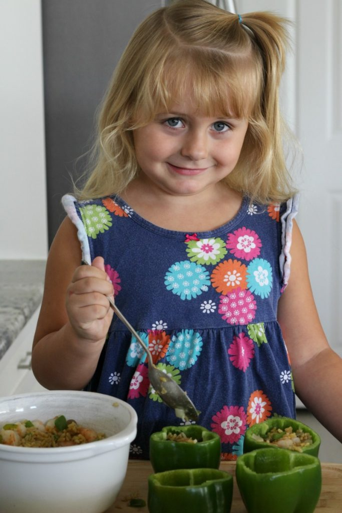 Even my littlest could help add the stuffed bell peppers with shrimp filling