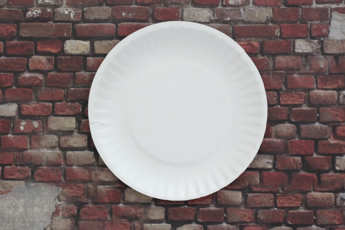 Make decorations from paper plates for an easy baseball party.