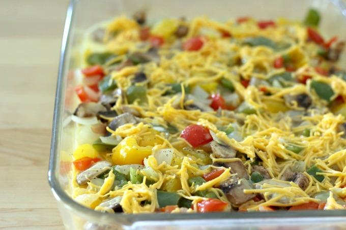 Pour the egg mixture over the fajita breakfast casserole.