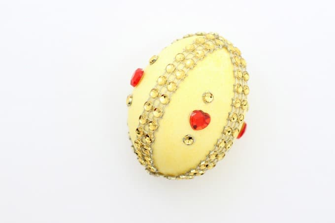 An Easter egg decorating idea for Belle is to combine yellow and red gems