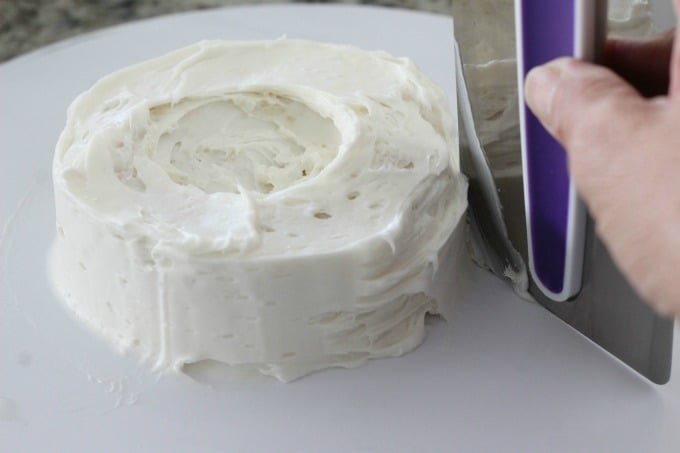 Start by frosting your mini cake