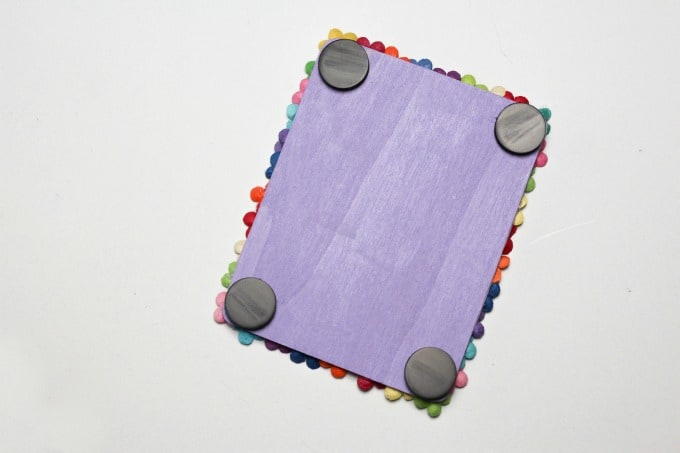 Glue magnets to the back of the picture frame craft